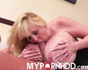 Blonde MILF Kayla Kleevage teasing cock between her boobs until it cums