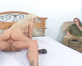 Busty blonde Candy Manson sucks hard dick in the presence of her husband