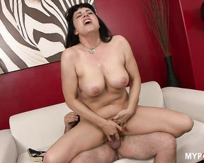 Busty MILF Claudine fucks her man