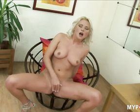 Sexy Kathy Anderson plays with  beautiful round tits