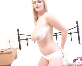 Hot blonde Charley undresses to show her big boobs