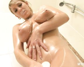 Hot blonde Demi rubs her big boobs with oil in the shower