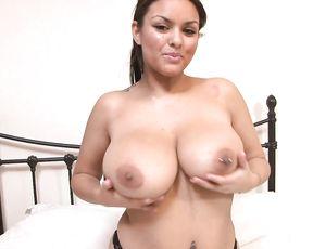 Sexy brunette Kelley demonstrates her big boobs