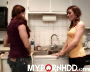 Two lesbians have some fun in the kitchen