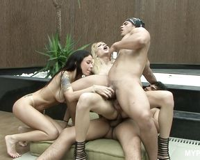 Busty brunette Monica Mattos and blonde tranny Laviny Albuquerque in the foursome
