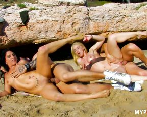 Hot drilled orgy on the beach with Yesenia and Angelica